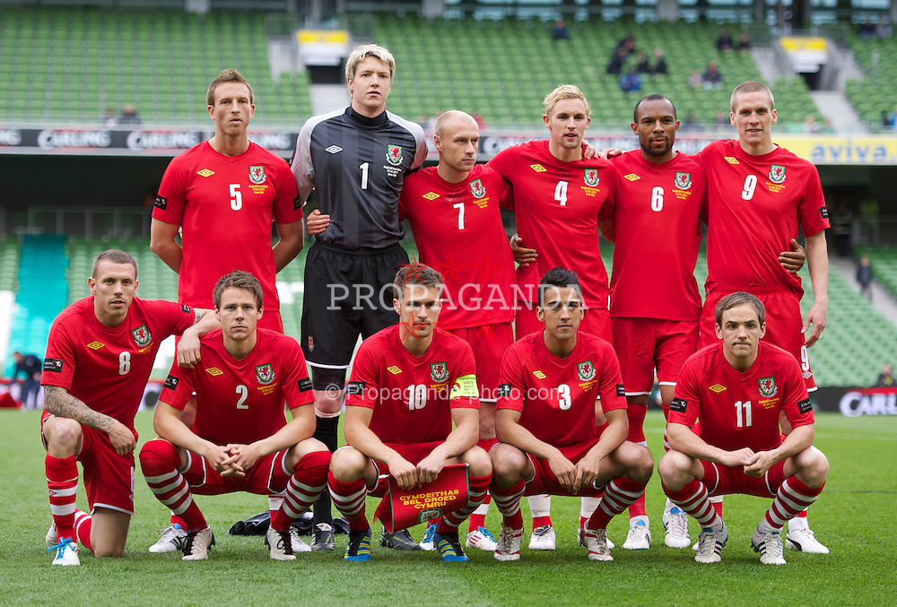 DUBLIN, REPUBLIC OF IRELAND - Friday, May 27, 2011: Wales' players line-up for a team group photograph before the Carling Nations Cup match against Northern Ireland at the Aviva Stadium (Lansdowne Road). Back row L-R: Danny Collins, goalkeeper Wayne Hennessey, David Cotterill, Jack Collison, Daniel Gabbidon, Steve Morison. Front row L-R: Craig Bellamy, Chris Gunter, captain Aaron Ramsey, Neil Taylor, David Vaughan. (Photo by David Rawcliffe/Propaganda)