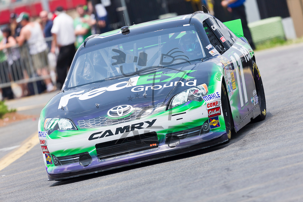 CONCORD, NC - MAY 26, 2012:  Denny Hamlin (11) brings his FedEx Toyota on the track for a practice session for the Coca-Cola 600 at the Charlotte Motor Speedway in Concord, NC.