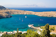 An aerial view of Lindos Bay, Lindos, Rhodes, Dodecanese Islands, Greece