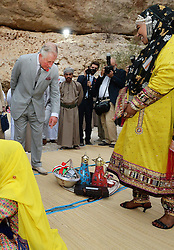 The Prince of Wales looks at gifts presented to him as he visits the Ras Al Shajar nature reserve in south east Oman during his official tour of the Middle East.