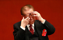 epa06272491 Former Chinese President Jiang Zemin lifts his glasses to wipe his eyes during the opening ceremony of the 19th National Congress of the Communist Party of China (CPC) at the Great Hall of the People (GHOP) in Beijing, China, 18 October 2017. China holds the 19th Congress of the Communist Party of China, the country's most important political event where the party's leadership is chosen and plans are made for the next five years. Xi Jinping is expected to remain as the General Secretary of the Communist Party of China for another five-year term.  EPA-EFE/HOW HWEE YOUNG