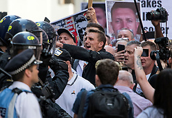 © Licensed to London News Pictures. 11/07/2019. London, UK. Supporters of activist Stephen Yaxley-Lennon Known as Tommy Robinson, clash with police outside The Old Bailey in London after he was jailed for nine months. The former leader of the English Defence League (EDL) is being sentenced for contempt of court for filming defendants at a trial at Leeds Crown Court and broadcast the video on social media. Photo credit: Ben Cawthra/LNP