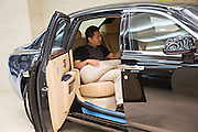 A Chinese millionaire shops for a Rolls Royce luxury car in Beijing, China