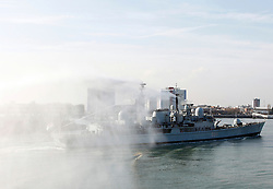 © under license to London News Pictures.  17/02/2011 HMS Manchester being welcomed by crowds and tugs at Portsmouth Harbour for the final time before being decommissioned, Picture credit should read: Bryan Moffat/London News Pictures