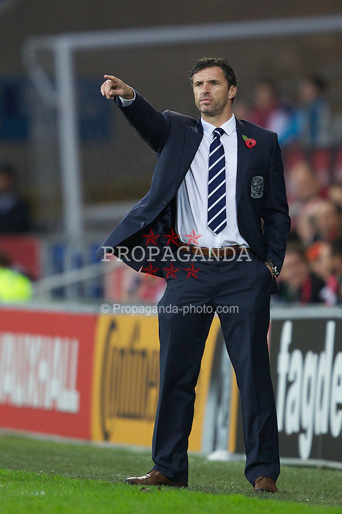 CARDIFF, WALES - Saturday, November 12, 2011: Wales' manager Gary Speed during the international friendly match against Norway at the Cardiff City Stadium. (Pic by Vegard Grott/Propaganda)
