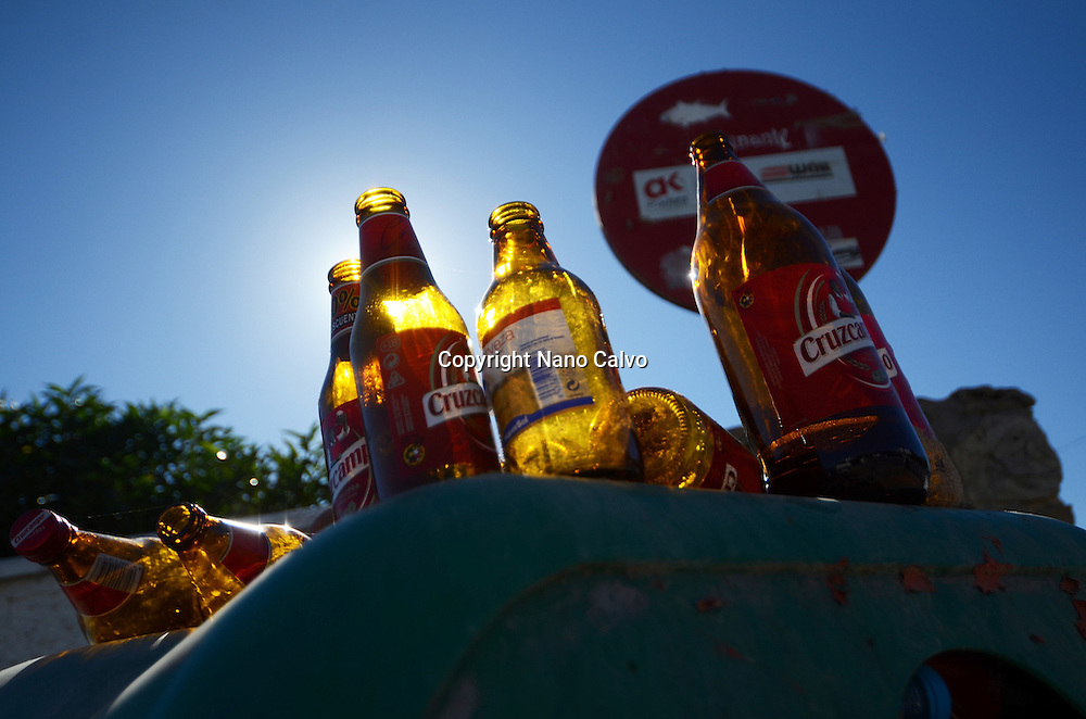Used beer bottles in trash bin