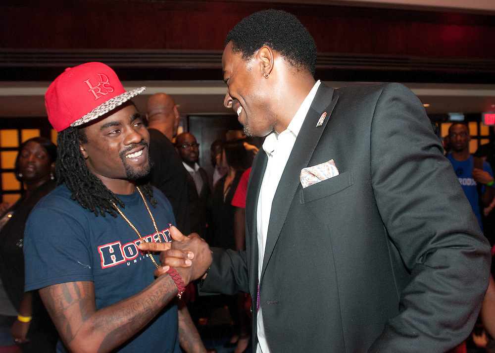 Rap star Wale, left, shakes hands with actor Lamman Rucker, right during the HBCU Alumni Mixer at the JW Marriott Friday night. (Photo by Alan Lessig)