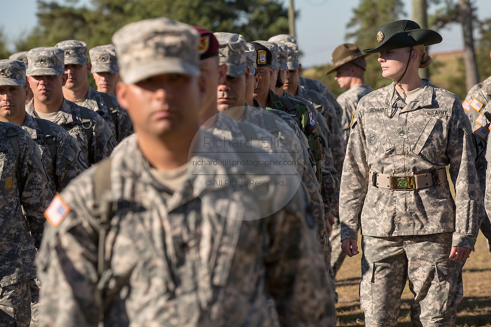 Male and female Drill Sergeant candidates at the US Army Drill Instructors School Fort Jackson during close order drill exercises September 27, 2013 in Columbia, SC. While 14 percent of the Army is women soldiers there is a shortage of female Drill Sergeants.