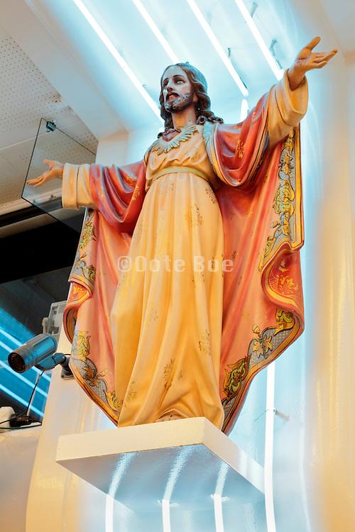 Statue of Jesus Christ at a souvenir shop in Lourdes, France