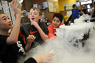 Riverdale Elementary School students Nick Fenove, Paul Jeannnetti, and Quinn Reyes interact with dry ice during a science program presented by the Discovery Museum, Feb. 26, 2014.<br /> Wicked Local staff photo/Kate Flock