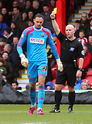 David BUTTON yellow card during the Sky Bet Championship match between Brentford and Middlesbrough at Griffin Park, London, England on 31 January 2015. Photo by Matthew Redman.