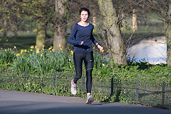 © Licensed to London News Pictures. 29/03/2020. London, UK. A woman jogging through Regents Park, London in the early morning sun, during a lockdown over the Coronavirus spread. Members of the public have been told they can only leave their homes to exercise briefly once a day, and to go to shops for essentials when absolutely necessary, in an attempt to fight the spread of COVID-19. Photo credit: Ben Cawthra/LNP