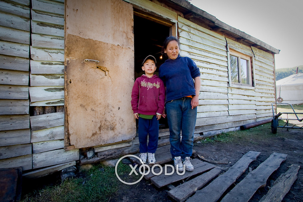 Mongolian boy and sister outside house (Gorkhi-Terelj national park, Mongolia - Sep. 2008) (Image ID: 080917-0916051a)