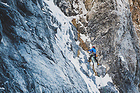 Nathan Smith makes a pre dawn approach to the mixed line, Bone Collector, M5, WI5, III, Little Cottonwood Canyon, Utah.