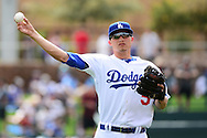 GLENDALE, AZ - MARCH 05:  Corey Seager #5 of the Los Angeles Dodgers warms up prior to the spring training game against the Arizona Diamondbacks at Camelback Ranch on March 5, 2016 in Glendale, Arizona.  The Dodgers won 7-2.  (Photo by Jennifer Stewart/Getty Images) *** Local Caption *** Corey Seager