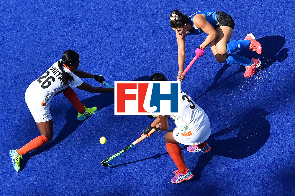 Argentina's Maria Granatto (R) vies with India's Sunita Lakra (L) and India's Deep Ekka  during the women's field hockey Argentina vs India match of the Rio 2016 Olympics Games at the Olympic Hockey Centre in Rio de Janeiro on August, 13 2016. / AFP / MANAN VATSYAYANA        (Photo credit should read MANAN VATSYAYANA/AFP/Getty Images)