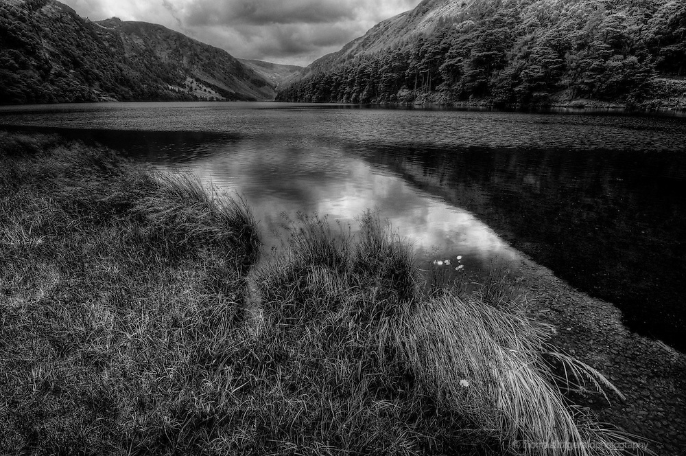 Glendalough upperlake surrounded by its rolling hills