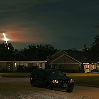 A long exposure view from a neighborhood in Orlando, Fla., as the Falcon 9 SpaceX rocket launches from the complex 40 pad at Cape Canaveral Air Force Station in Cape Canaveral, Fla. on Sunday, Oct. 7, 2012. The rocket launched at  8:35 PM Sunday on a supply mission to the International Space Station.  (AP Photo/Alex Menendez)