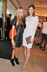 Left to right, FLORENCE BRUDENELL-BRUCE and AMBER ANDERSON at a party to celebrate the launch of the Vogue Fashion's Night Out held at Mulberry, Bond Street, London on 6th September 2012.