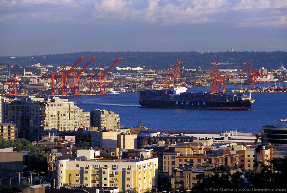 A container ship leaves the Port of Seattle.