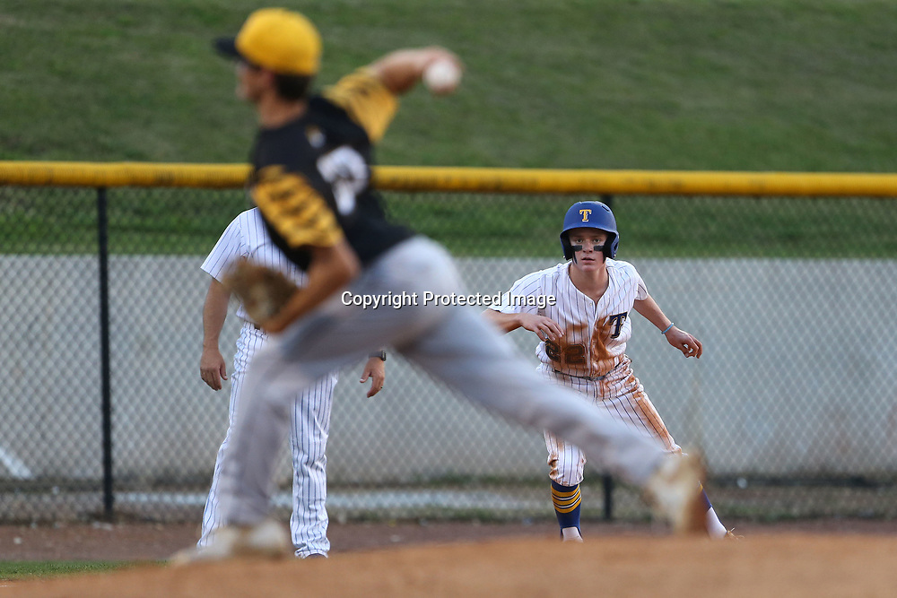 Tupelo's Gatlin Farrar leads off from third base as Hernando pitcher Hunter Riggins throws a pitch in the third inning.