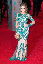 © Licensed to London News Pictures. 14/02/2016. London, UK. POPPIE JAMIE arrives on the red carpet at the EE British Academy Film Awards 2016 Photo credit: Ray Tang/LNP