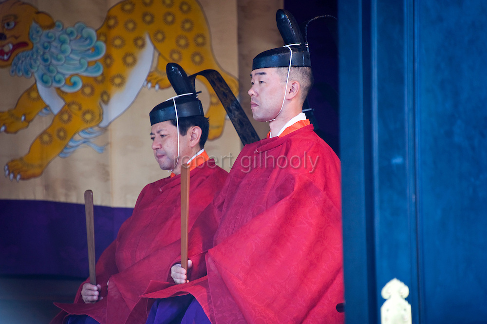 Priests attend a ritual inside the inner sanctuary during the annual Reitaisai Grand Festival at Tsurugaoka Hachimangu Shrine in Kamakura, Japan on  14 Sept. 2012.  Sept 14 marks the first day of the 3-day Reitaisai festival, which starts early in the morning when shrine priests and officials perform a purification ritual in the ocean during a rite known as hamaorisai and limaxes with a display of yabusame horseback archery. Photographer: Robert Gilhooly