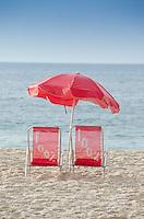 Beach chairs and beach umbrella on Copacabana beach. Rio de Janeiro, Brazil.