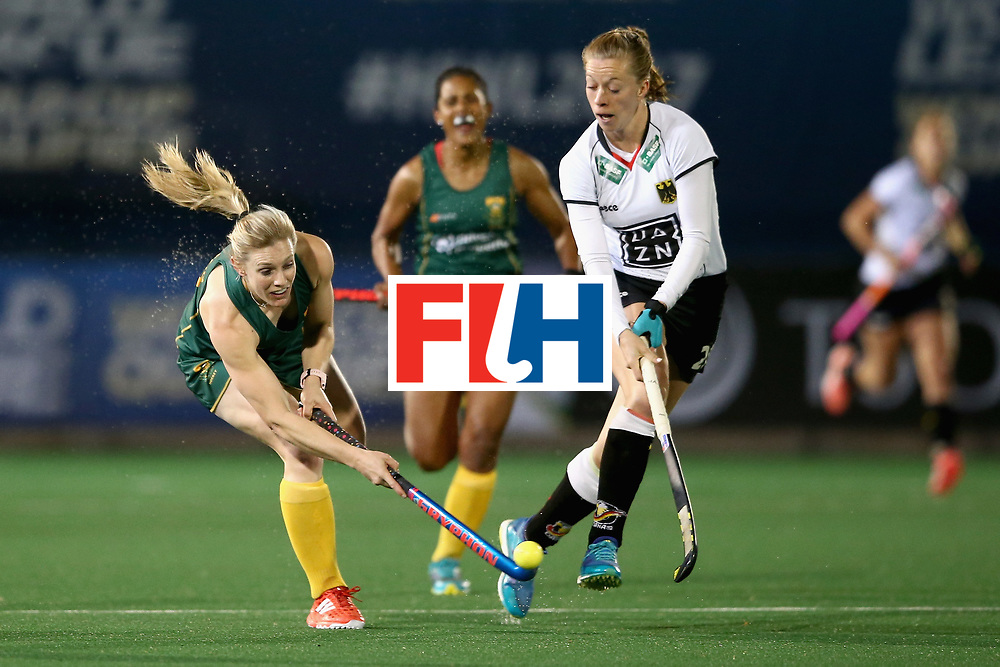 JOHANNESBURG, SOUTH AFRICA - JULY 18: Bernadette Coston of South Africa and Franzisca Hauke of Germany battle for possession during the Quarter Final match between Germany and South Africa during the FIH Hockey World League - Women's Semi Finals on July 18, 2017 in Johannesburg, South Africa.  (Photo by Jan Kruger/Getty Images for FIH)