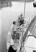 """03/08/1967<br /> 08/03/1967<br /> 03 August 1967<br /> Arrival of """"Saint Brendan II"""" in Dublin. Image shows Captain Louis Lourmais (rear) and Vint Lloyd of Nova Scotia, on board the """"Saint Brendan II"""" a curragh they hoped to sail from Fenit Co. Kerry to America by the Northern Route (Ireland, Iceland, Greenland, North America) and land between Boston and Rhode Island to see if Brendan the Navigator could have reached North America in the 6th century AD. Captain Lourmais had the curragh built to specifications resembling those of what was believed to be the type of craft available in the  6th century. It was the first time the curragh had been in the water since its construction."""