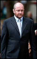 Scott Young arrives at the High Court, London, for the judgement in his divorce case with ex-wife Michelle Young. Friday, 22nd November 2013. His wife has been awarded a £20million divorce settlement but immediately demanded more, branding the judgement 'disgraceful' and her husband a 'powerful maniac' Picture by  i-Images / i-Images