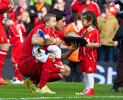 LIVERPOOL, ENGLAND - Sunday, May 11, 2014: Liverpool's Luis Suarez with his daughter Defina and son Benjamin, after the final game of the season, a 2-1 victory over Newcastle United, during the Premiership match at Anfield. (Pic by David Rawcliffe/Propaganda)