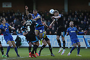 AFC Wimbledon defender Darius Charles (32) header is blocked by Portsmouth striker Michael Smith (21) during the Sky Bet League 2 match between AFC Wimbledon and Portsmouth at the Cherry Red Records Stadium, Kingston, England on 26 April 2016.
