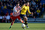 Stevenage striker Greg Luer and Oxford forward Danny Hylton bate for the ball during the Sky Bet League 2 match between Oxford United and Stevenage at the Kassam Stadium, Oxford, England on 25 March 2016. Photo by Alan Franklin.