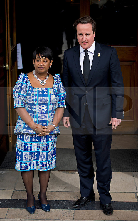 © London News Pictures. 22/04/2013. London, UK.  Prime Minister DAVID CAMERON being greeted by DOREEN LAWRENCE, Mother of Stephen Lawrence as he arrives at a memorial service at St Martins in the Field Church in London marking the 20 anniversary of the murder of Stephen Lawrence. Stephen Lawrence was murdered in a racist attack while waiting for a bus in South London on the evening of 22 April 1993. Photo credit : Ben Cawthra/LNP