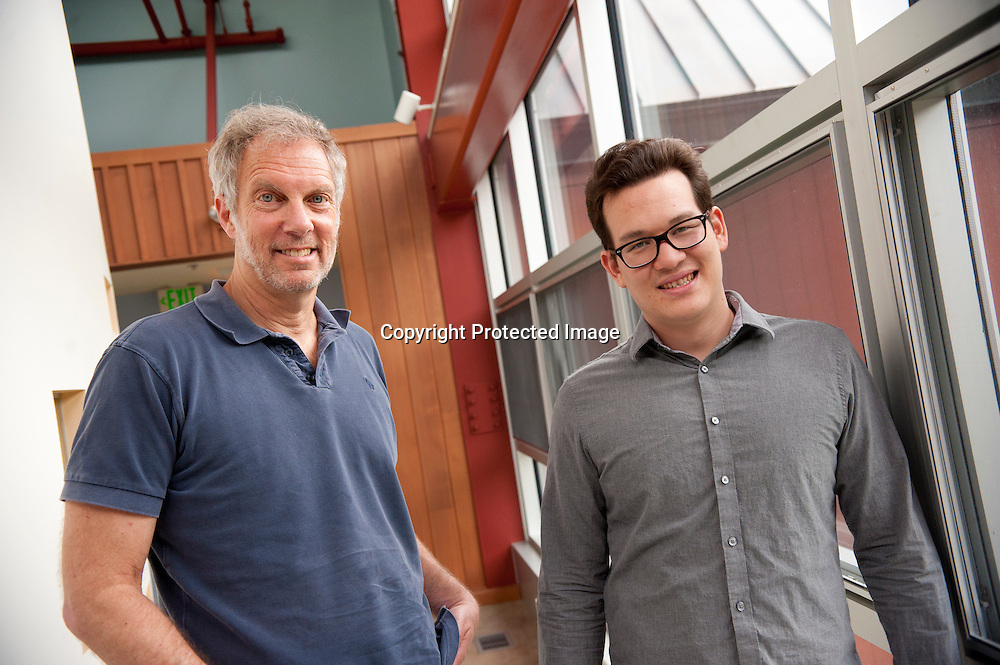 "Robert Pollin (left), Co-Director of the Political Economy Research Institute at University of Massachusetts in Amherst and Thomas Herndon (right) Graduate student at the University of Massachusetts in Amherst, pose for a portrait in the Gordon Hall building in the UMass campus in Amherst, Massachusetts on June 26, 2013. Pollin and Herndon wrote an article that critiques and finds flaws in Reingart's and Rogoff's ""Growth in a Time of Debt"" article."