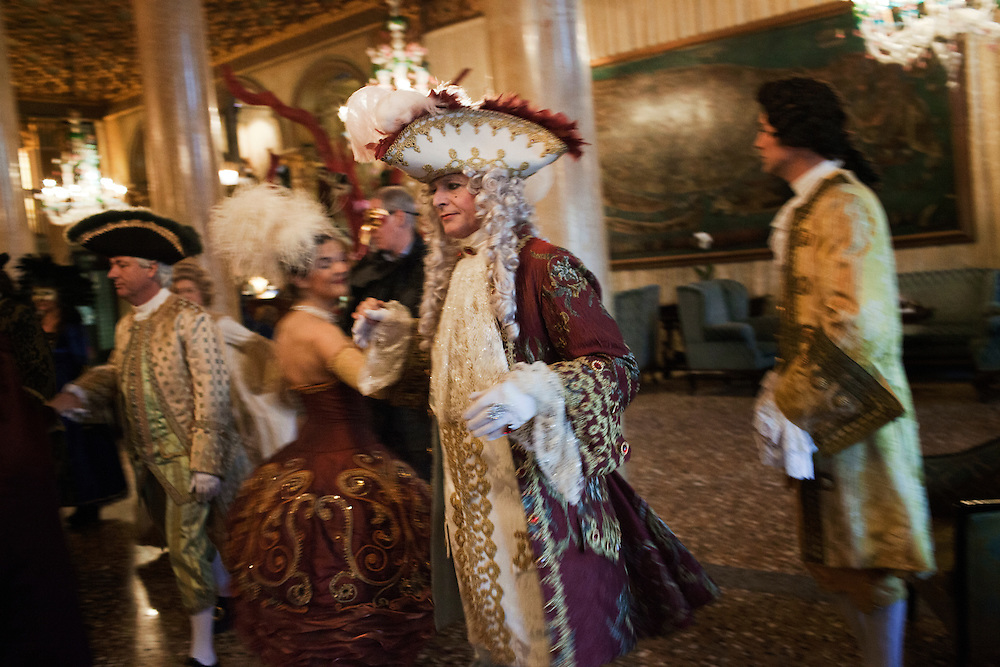 Tourists dressed in traditional costume from atelier Tiepolo learn traditional dance in Hotel Danieli in Venice during the carnival.