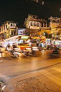 Motorcycles whiz by during rush hour. Hoan Kiem, Hanoi, Vietnam