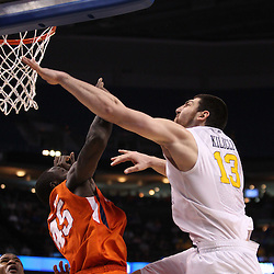Mar 17, 2011; Tampa, FL, USA; Clemson Tigers forward/center Jerai Grant (45) fouls West Virginia Mountaineers forward Deniz Kilicli (13) during the second half of the second round of the 2011 NCAA men's basketball tournament at the St. Pete Times Forum. West Virginia defeated Clemson 84-76.  Mandatory Credit: Derick E. Hingle