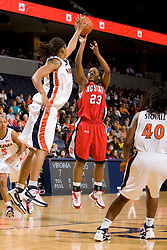 Virginia forward Lyndra Littles (1) blocks a shot by N.C. State guard Shayla Fields (23).  The Virginia Cavaliers faced NC State Wolfpack women's basketball team at the John Paul Jones Arena in Charlottesville, VA on February 1, 2008.