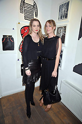 Left to right, sisters DAISY DE VILLENEUVE and POPPY DE VILLENEUVE at a private view entitled 'No Love Lost' by artists Daisy de Villeneuve and Natasha Law held at Eleven, 11 Eccleston Street, London SW1 on 31st March 2009.
