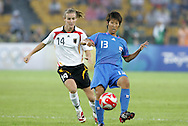 21 August 2008: Ayumi Hara (JPN) (13) and Simone Laudehr (GER) (14). Germany's Women's National Team defeated Japan's Women's National Team 2-0 at the Worker's Stadium in Beijing, China in the Bronze Medal match in the Women's Olympic Football tournament.