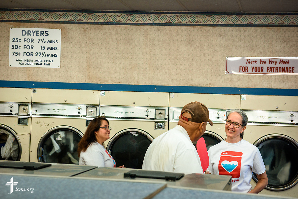 "Roxanne Johnson, a volunteer from St. Paul Lutheran Church, San Antonio, Texas, talks with Ray at the Laundry Love event on Wednesday, Aug. 2, 2017, at the E-Z Wash laundromat in San Antonio. The monthly ministry event is supported by a grant through the ""Stand With Your Community"" program, which was made possible by a partnership between the LCMS, Thrivent Financial and Lutheran Church Extension Fund. LCMS Communications/Erik M. Lunsford"