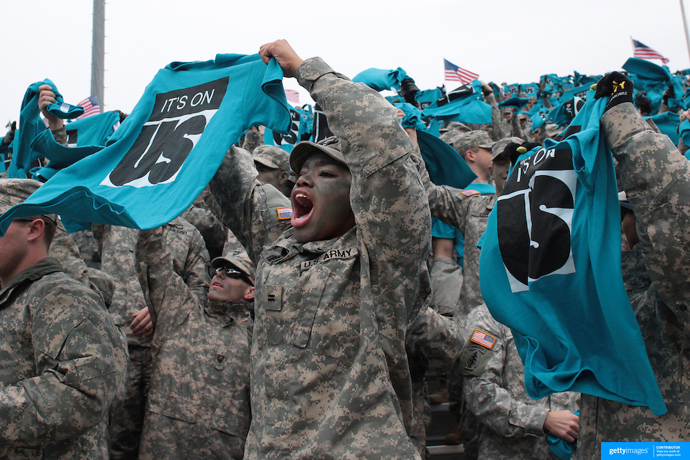 """Army personnel wave tee shirts supporting the """"It's On Us"""" initiative, an awareness campaign to help put an end to sexual assault on college campuses during the Army Black Knights Vs Air Force Falcons, College Football match at Michie Stadium, West Point. New York. Air Force won the game 23-6. West Point, New York, USA. 1st November 2014. Photo Tim Clayton"""