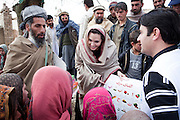 Kabul: Goodwill Ambassador, Angelina Jolie, presents education materials to both local Headteacher, Gul Rahman and young schoolgirls  in the village of Qala Gudar, Qarabagh District, some 28km outside Kabul.<br /> <br /> Angelina Jolie was visiting the site where she will fund a new girls primary school.<br /> <br /> Girls are only currently studying part of the year in the open air in the grounds of a local mosque and limited to Grade 4 due to lack of a school building<br /> <br /> Afghanistan. /UNHCR/Jason Tanner/February 2011