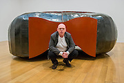 Tate Britain launches its major spring show, exhibiting the work of Turner Prize-winning artist Richard Deacon (b.1949 - pictured). It includes large sculptures made of twisted wood, metal, and ceramic such as: Fold 2012, a towering sculpture weighing over 12 tonnes and made of 60 shimmering glazed ceramic bricks; After 1998, a huge serpentine wooden structure that is over 9 metres at its longest point; Struck Dumb 1988  (pictured); and Out of Order 2003, a sprawling sculpture constructed from ribbons of steamed wood. The Tate Britain, London, UK 03 February 2014. Guy Bell, 07771 786236, guy@gbphotos.com