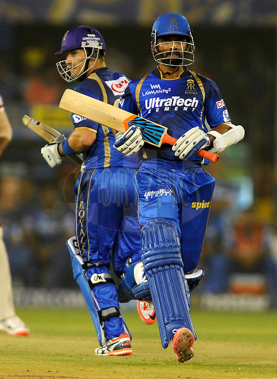 Shane Watson captain of Rajasthan Royals and Ajinkya Rahane of Rajasthan Royals run between the wickets during match 18 of the Pepsi IPL 2015 (Indian Premier League) between The Rajasthan Royals and The Kings XI Punjab held at the Sardar Patel Stadium in Ahmedabad , India on the 21st April 2015.<br /> <br /> Photo by:  Pal Pillai / SPORTZPICS / IPL