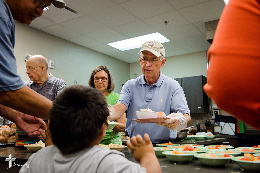 "Volunteers from Faith Lutheran Church, Sioux Falls, SD., serve lunch at the Bishop Dudley Hospitality House homeless shelter on Tuesday, Aug. 1, 2017, in Sioux Falls. The meals are provided by a grant through the ""Stand With Your Community"" program, which was made possible by a partnership between the LCMS, Thrivent Financial and Lutheran Church Extension Fund. LCMS Communications/Erik M. Lunsford"