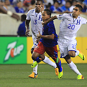 Herold Charles, Haiti, is held back by Jorge Aaron Claros, Honduras, (right), during the Haiti V Honduras CONCACAF Gold Cup group B football match at Red Bull Arena, Harrison, New Jersey. USA. 8th July 2013. Photo Tim Clayton