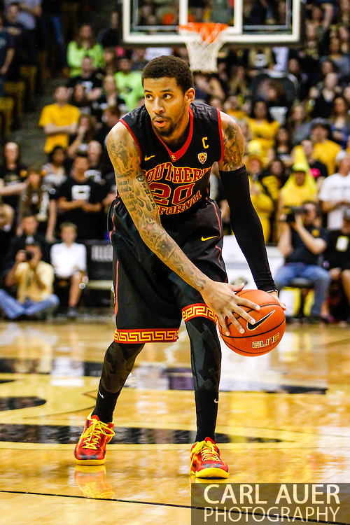 January 18th, 2014:  USC Trojans senior guard J.T. Terrell (20) looks for a opening in the first half of action in the NCAA Basketball game between the USC Trojans and the University of Colorado Buffaloes at the Coors Events Center in Boulder, Colorado